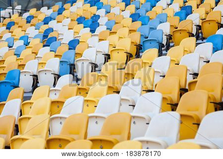 Close-up view of white red and yellow stadium seats on Olympic stadium