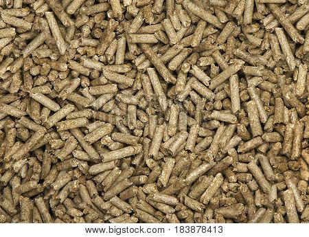 Chaotic wood pellets pattern as abstract background