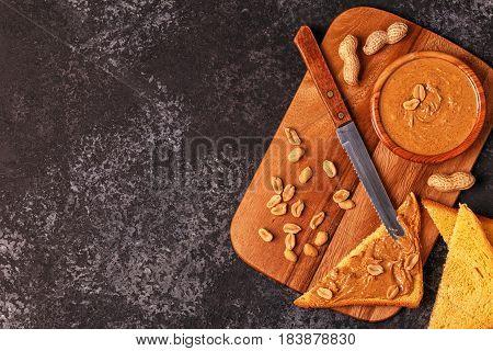 Bowl Of Peanut Butter On Wooden Board.