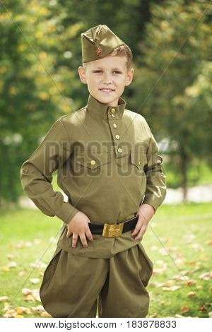 Russian boy in military uniform of the Soviet Army of the Second World War