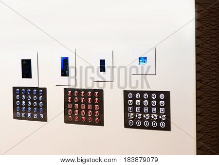 Elevator many buttons 3 multicolor panels. On white background