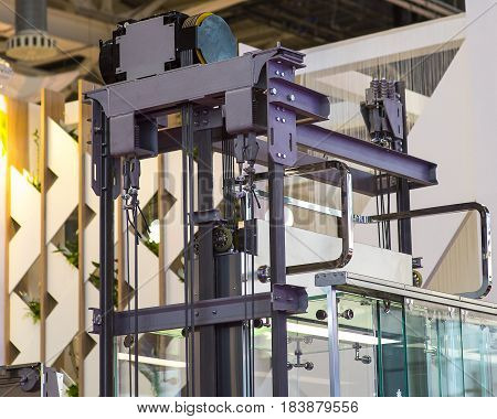 Elevator Installation, Lift Technician Installing a Modern Elevator.