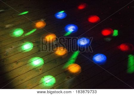 Colorful disco lights on the dance floor at a discotheque without people
