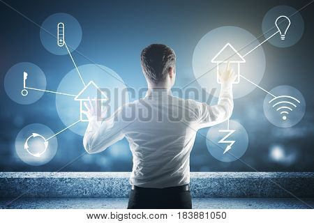 Abstract rooftop with futuristic interface of smart home automation assistant on a virtual screen and a businessman managing buttons. 3D Rendering