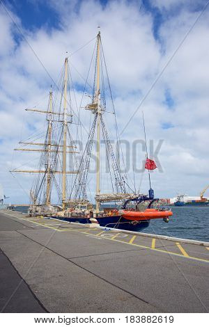 FREMANTLE,WA,AUSTRALIA-OCTOBER 14,2016: STS Leeuwin II tall ship with three masts moored in port with a cloudy sky in Fremantle, Western Australia.
