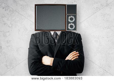 Obsolete TV screen headed businessman on concrete background. Mock up 3D Rendering