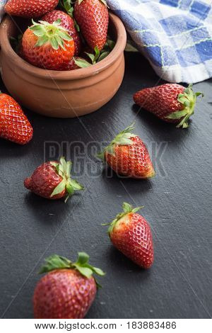 Red Ripe Strawberries  On Table And In A Bowl.
