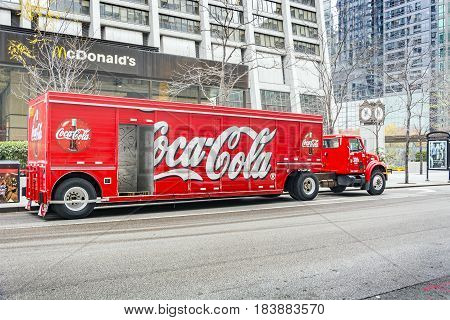 Chicago IL october 2016: A red Coca Cola delivery tractor trailer truck is parked in central street of Chicago