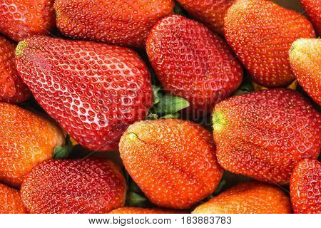 Fresh red ripe strawberries closeup background .