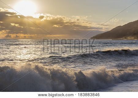 Beautiful sunset over the seashore with waves