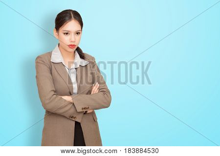 Business woman portrait on blue wall background.