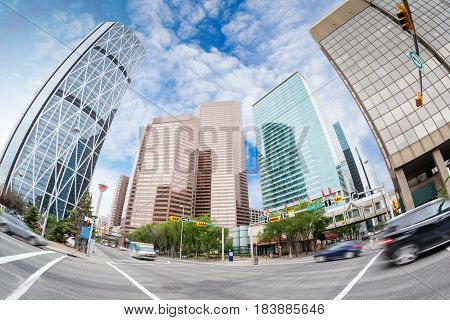 Wide angle view of Calgary downtown on Centre Street showing tall corporate office skyscrapers and the iconic Calgary Tower in the background. Calgary is Alberta's largest city and Canada's third-largest municipality.