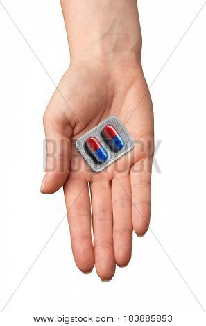 pills in a hand isolated on white background. medicine.