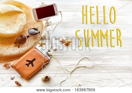 Hello Summer Text , Travel Vacation Concept, Space For Text. Selfie Stick Phone Camera Passport Mone