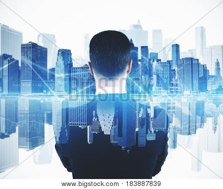 Back view of young businessman on abstract blue city background with arrows. Forex concept. Double exposure