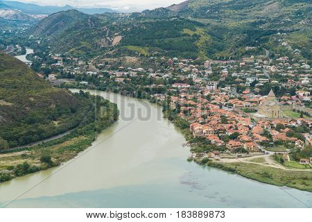 The top view of Mtskheta, ancient city in Georgia at the confluence of the rivers Mtkvari and Aragvi. Svetitskhoveli Cathedral, Ancient Georgian Orthodox Church, Unesco Heritage In The Center.