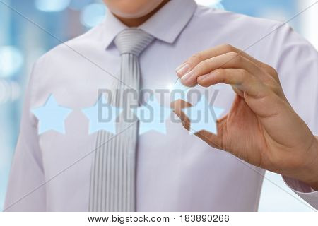 Businessman Is Holding The Fifth Star Rating.
