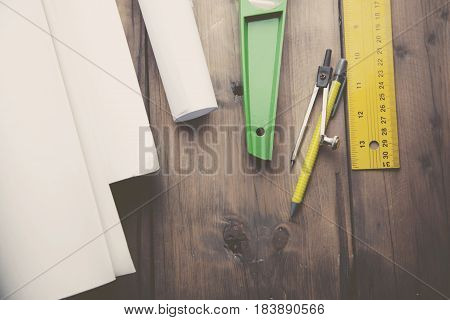 drawings and stationery on the wooden table