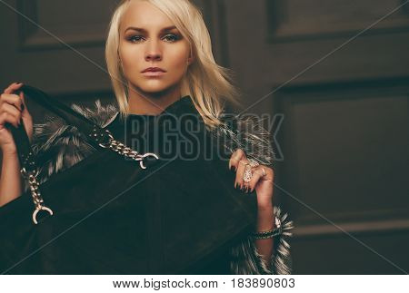 Stylish young blond woman wearing a winter look