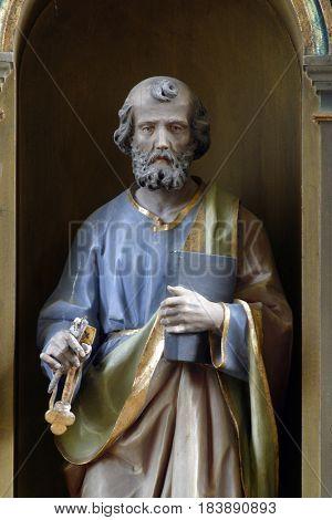 SISLJAVIC, CROATIA - AUGUST 23: Saint Peter statue at the altar in the Parish Church of Saint Joseph in Sisljavic, Croatia on August 23, 2011.