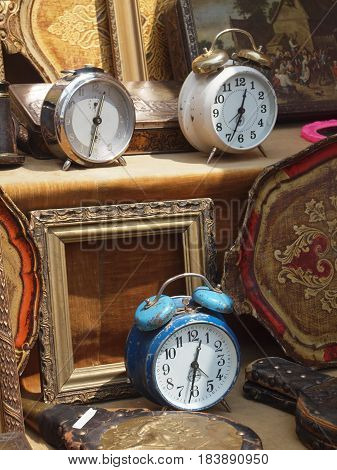 Alarm clocks and frames for sale at the flea market.