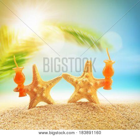 Crazy starfish having fun on summer beach