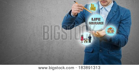 Life Insurance.Businessman drawing and representing a life insurance concept.Protection