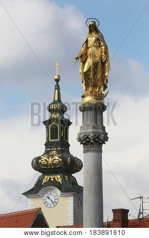 ZAGREB, CROATIA - APRIL 07: Golden statue of Virgin Mary and church of St. Mary at Tkalciceva street in Zagreb, Croatia on April 07, 2015.
