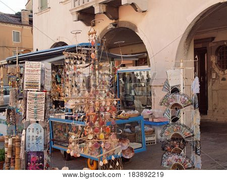 Chioggia, Italy. Souvenirs for sale on the main street.