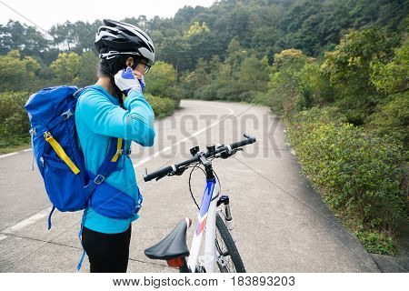 cyclist cycling mountain bike on forest trail