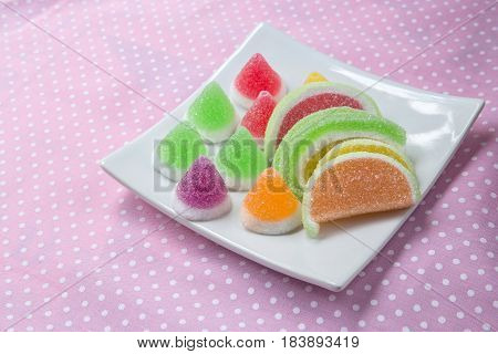 candies. jelly candies in plate on a background. jelly candies in bowl on a background.