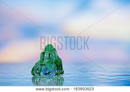 glass tropical sea  shell with sea scape, shallow dof