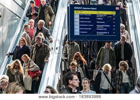 Berlin Germany - april 27: Traveling people on crowded escalator inside main train station (Hauptbahnhof) in Berlin.