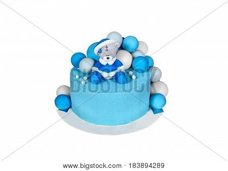 Children's cake on a white background of the mastic with teddy bear blue