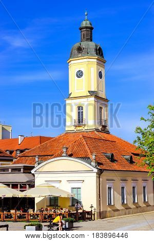Bialystok Poland - April 29 2012: Town hall tower over red tile roof on central square of Kosciusko Market in Bialystok Poland. Museum of Podlasie in Baroque style 1745-1761 architect Ian Klemm