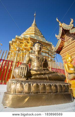Buddha statue in Wat Doi Suthep - buddhist temple in Chiang Mai Thailand.