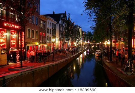 Famous Red Lights District at evening in Amsterdam, Holland (Netherlands).