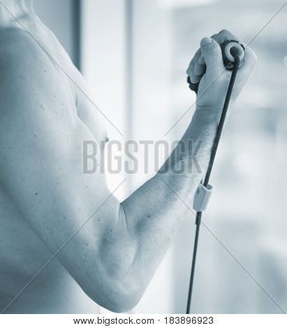 Man Exercising With Bands