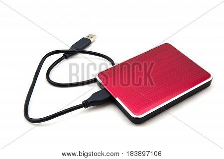 Red External Hard Drive With Usb Cable On The White Background.