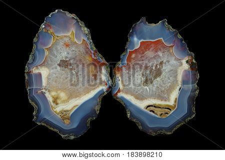 A cross section of the agate stone with quartz geode. Multicolored silica rings colored with metal oxides are visible. Origin: Asni Atlas Mountains Morocco.