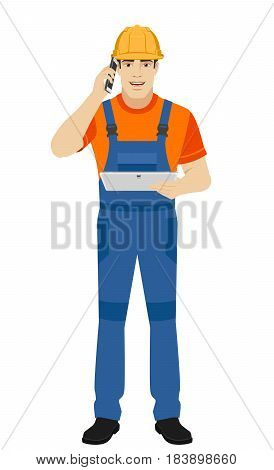 Builder holding digital tablet and talking on the mobile phone. Full length portrait of builder character in a flat style. Vector illustration.
