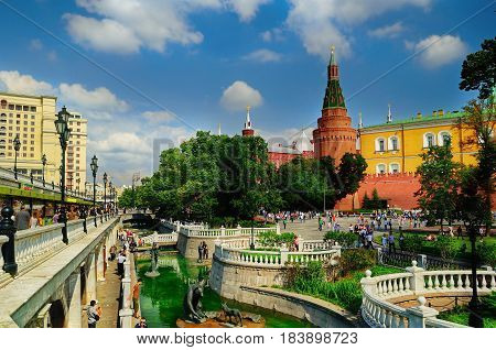 MOSCOW RUSSIA- AUGUST 12 2012. Alexander Garden and Moscow Kremlin towers. Alexander Garden one of the first urban public parks in Moscow Russia. Moscow city view. Summer day in Moscow park.