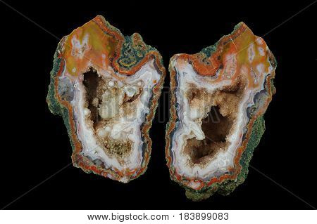 A cross section of the agate stone. Multicolored silica rings colored with metal oxides are visible. Inside geode is a