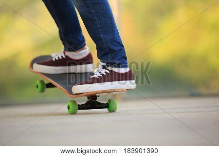 close up of skateboarder legs skateboarding outdoor