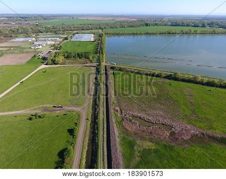 Rural Landscape. View From Above. On The Horizon There Is A Fish Hatchery, A Field, Forest Belts And