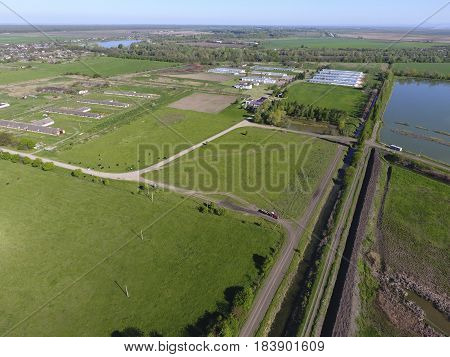 Rural Landscape. View From Above. On The Horizon There Is A Poultry Farm, A Field, Forest Belts And