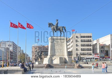 ANKARA, TURKEY - 28 APRIL 2017: The statue of Ataturk and national flags of modern Turkey in Ulus - Ankara, Turkey