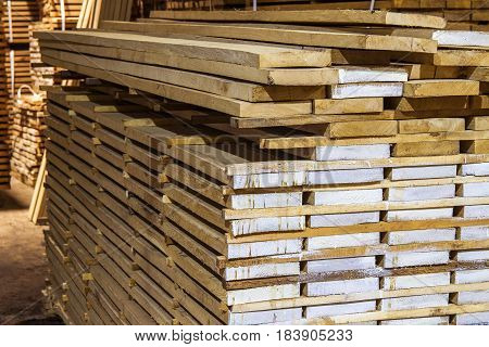 Warehouse packed with variety of timber for construction and repair. Wood timber construction material
