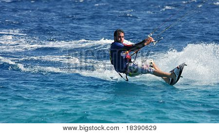 EILAT, ISRAEL - MARCH 31: Unidentified kitesurfer glides on water surface on Red Sea March 31, 2010 in Eilat Israel.