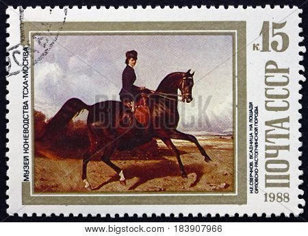 RUSSIA - CIRCA 1988: a stamp printed in Russia shows Horsewoman Riding an Orlov-Rostopchin Horse Painting by N. E. Sverchkov Russian Painter circa 1988